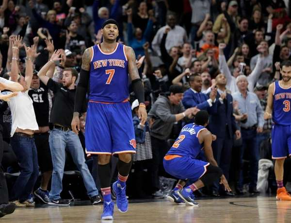 New York Knicks forward Carmelo Anthony walks off
