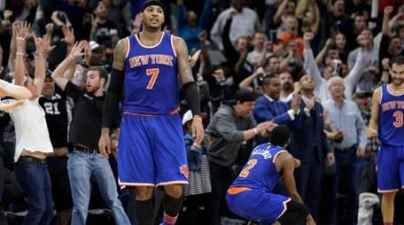New York Knicks forward Carmelo Anthony walks off