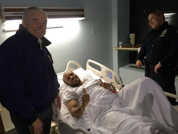 NYPD Commissioner William Bratton visits Officer Sherrod Stuart