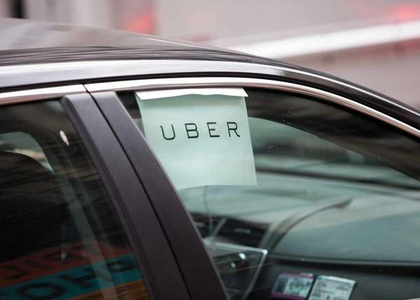 An Uber car waits for a fare in