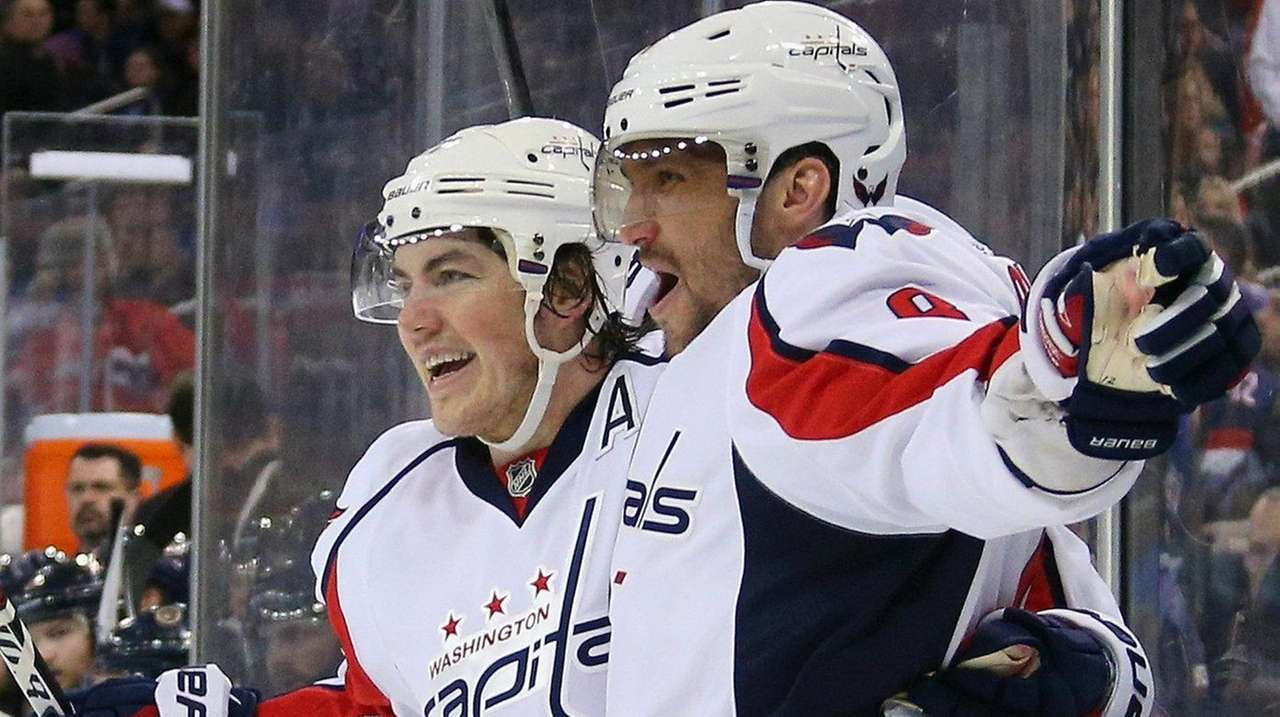 T.J. Oshie, left, congratulates Alex Ovechkin on