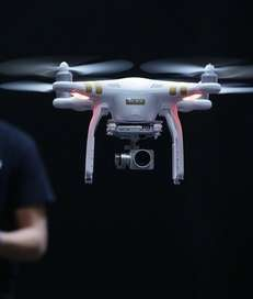 A DJI employee demonstrates flying a drone at