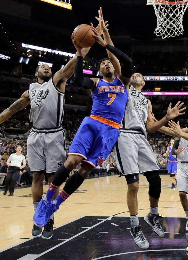 New York Knicks forward Carmelo Anthony is fouled