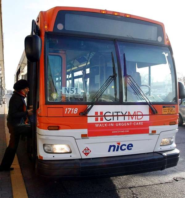 An N51 bus stops at the Merrick LIRR