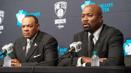 Nets coach Lionel Hollins, left, and general manager