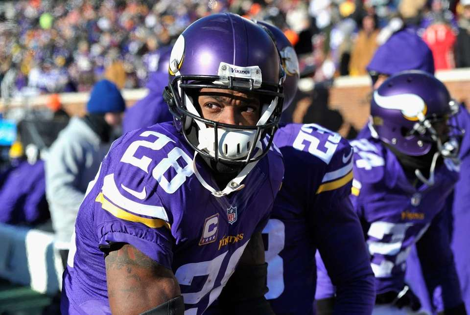 Adrian Peterson #28 of the Minnesota Vikings looks