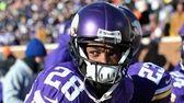Adrian Peterson #28 of the Minnesota Vikings looks