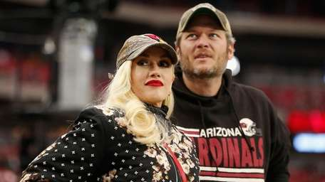 Stefani and Shelton, seen at a football game