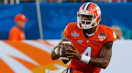 Clemson quarterback Deshaun Watson looks to pass during