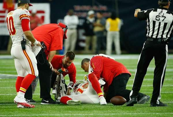 Trainers check on Jeremy Maclin of the