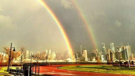 A rare double rainbow stretches over the Manhattan