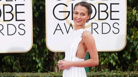 Alicia Vikander arrives at the 73rd annual Golden