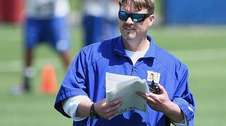 New York Giants offensive coordinator Ben McAdoo looks