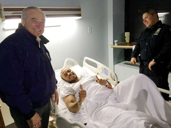 NYPD Commissioner William Bratton, left, visits wounded officer
