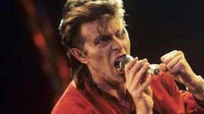 British musician David Bowie performing during a concert