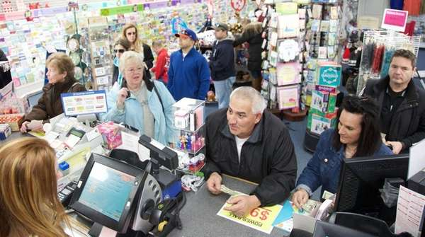 People line up Saturday to buy Powerball tickets