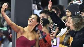 USA and Houston Dashs midfielder Carli Lloyd poses