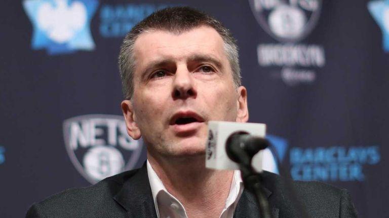 Nets owner Mikhail Prokhorov speaks to the media