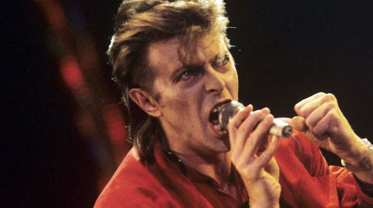 David Bowie performs during the
