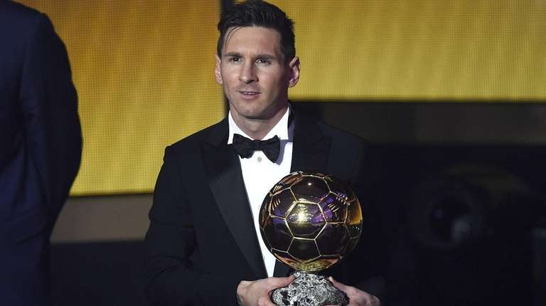 FC Barcelona and Argentina's forward Lionel Messi holds