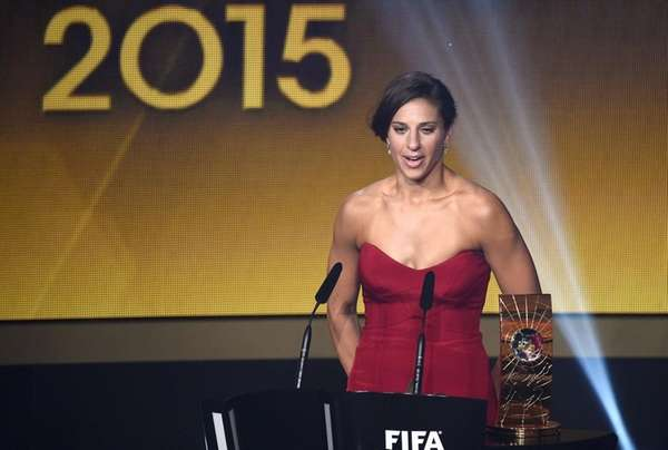 USA midfielder Carli Lloyd speaks after receiving
