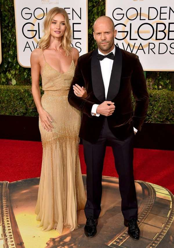 Rosie Huntington-Whiteley and fiance Jason Statham arrive at