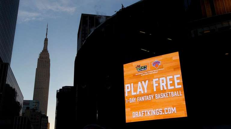 An electronic advertisement for DraftKings hangs on Madison