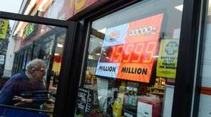 A Powerball sign reads $999 million dollars in