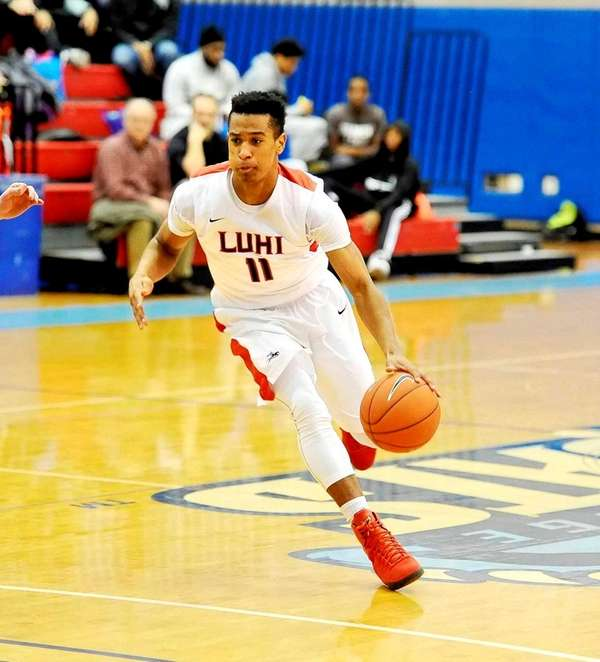 Devonte Green of Long Island Lutheran dribbles against