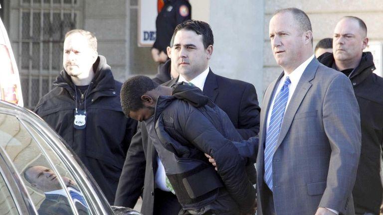 Nassau County police escort Jakwan Keller out of