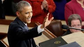 President Barack Obama waves before giving his State