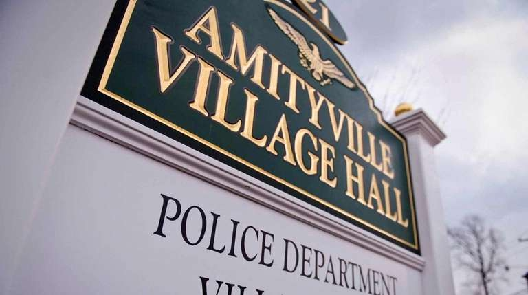 A sign outside of Amityville Village Hall, where