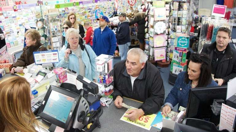 People line up to buy Powerball tickets at