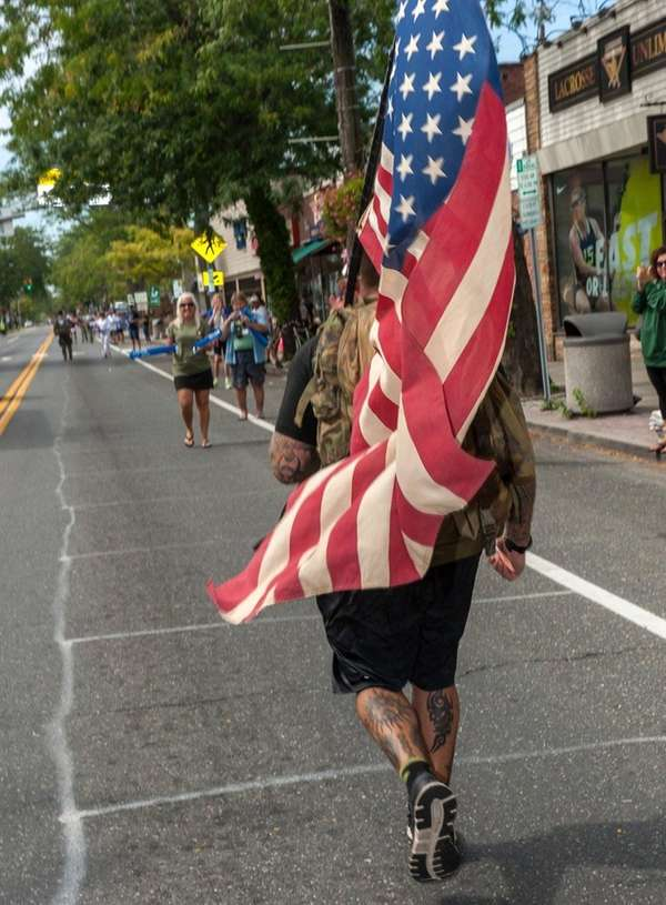 A U.S. Marine runs in the Suffolk County