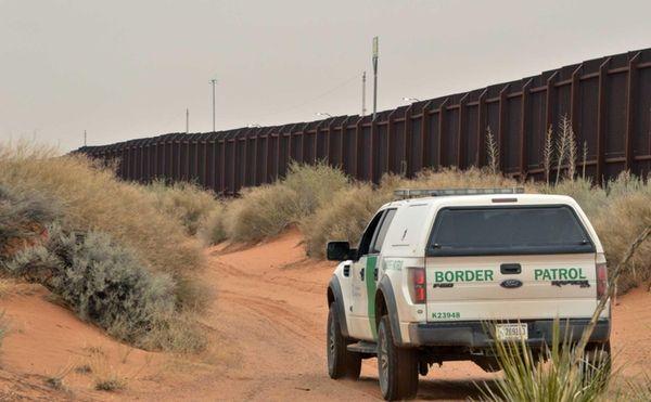 A U.S. Border Patrol agent drives near the