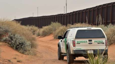 A U.S. Border Patrol agent drives near the