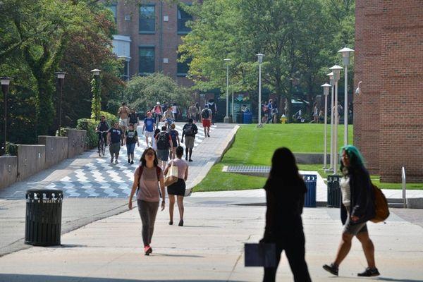 Students walk near Frey Hall, the Chemistry