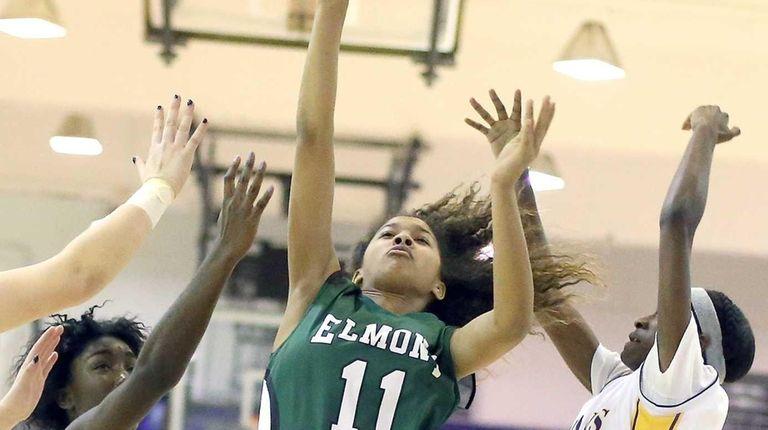 Elmont's Giavanna Faison gets the basket and the