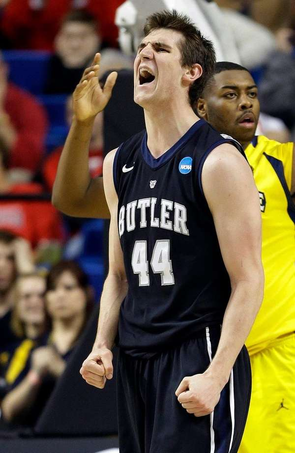 Butler center Andrew Smith reacts after being