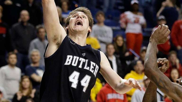 Butler center Andrew Smith shoots against the