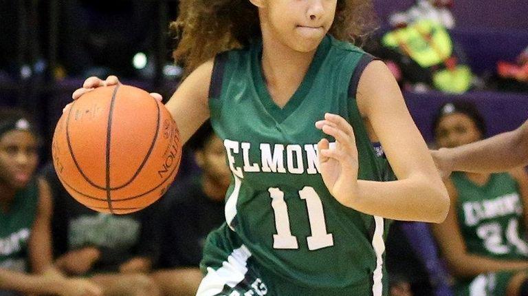 Elmont's Giavanna Faison turns corner during the Elmont