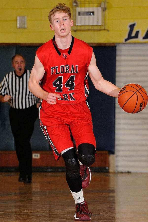 TJ Cluess of Floral Park dribbles downcourt during