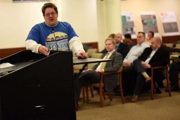 Paul Floroff, 33, of Glen Head, speaks at