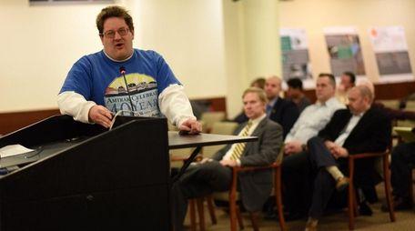 Paul Floroff, 33, of Glen Head, speaks at