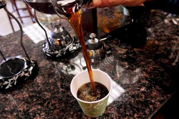 Fresh siphoned coffee is poured at Georgio's Coffee