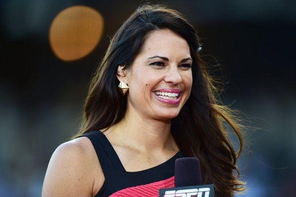ESPN sideline reporter Jessica Mendoza looks on