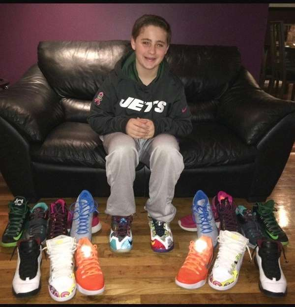 Justin Stern with his sneaker collection.