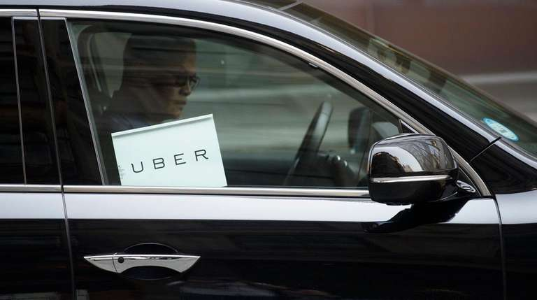 An Uber car idles after dropping of