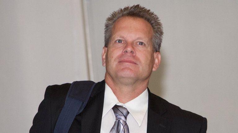 Scott Greene, walks in the hall of criminal