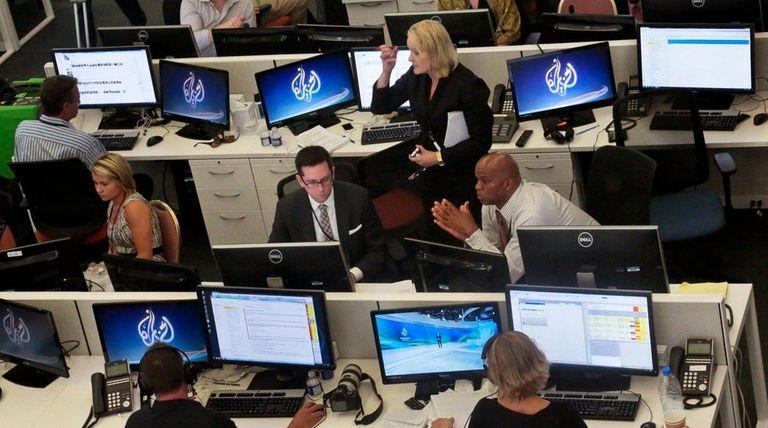Al Jazeera America editorial newsroom staff prepare